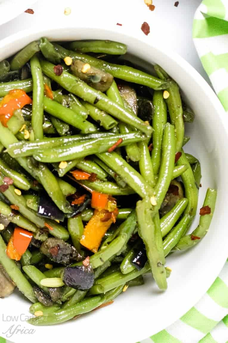close up image for sauteed green beans and mushrooms